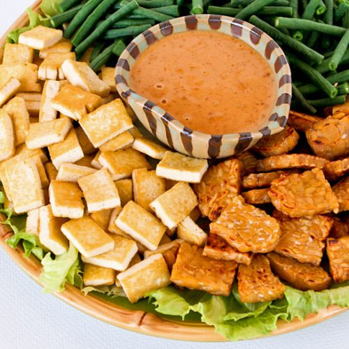 This Vegan Gado-gado Salad with a no-cook peanut butter dressing is a simplified version of a popular Indonesian dish. It is deliciously meaty and crunchy.   RotiNRice.com