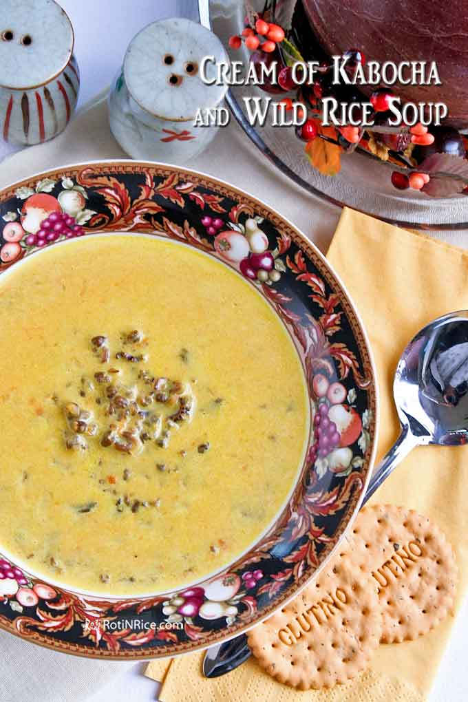 Creamy soup served with crackers.