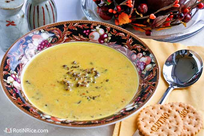 Cream of Kabocha and Wild Rice Soup served with crackers.