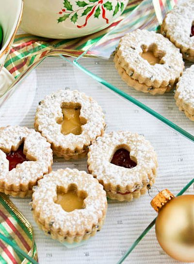 These sugar-dusted, jam-filled, egg-free, and sweetly scented Lavender Linzer Cookies are a must-have for the holidays. They are so festive and delicious! | RotiNRice.com #linzercookies #lavenderrecipes #christmascookies