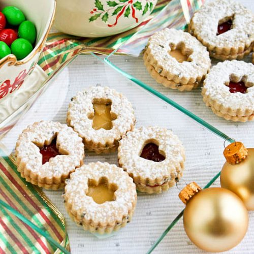 These sugar-dusted, jam-filled, egg-free, and sweetly scented Lavender Linzer Cookies are a must-have for the holidays. They are so festive and delicious!   RotiNRice.com #linzercookies #lavenderrecipes #christmascookies