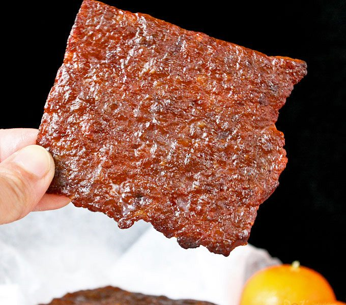 Bak Kwa is a popular snack and gift during the Chinese New Year. These barbecued wafer thin pieces of sweet and salty pork jerky are simply irresistible. | RotiNRice.com #bakkwa #porkjerky #chinesenewyear #lunarnewyear