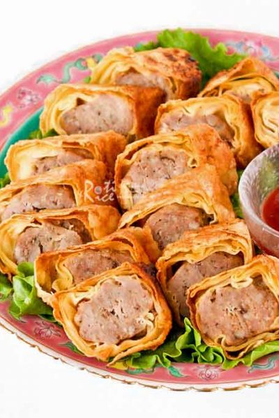 Lobak (Five-Spice Meat Rolls) are delicious pork rolls wrapped in beancurd sheets. These are steamed and pan fried. Just as tasty as the deep fried version.   RotiNRice.com