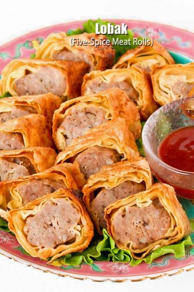 Pan fried Lobak (Five-Spice Meat Rolls) served with sweet chili sauce.