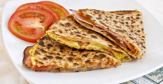 These Gluten-Free Ham and Cheese Breakfast Quesadillas are so easy to prepare. The addition of tomatoes and eggs make them even more tasty.   Food to gladden the heart at RotiNRice.com