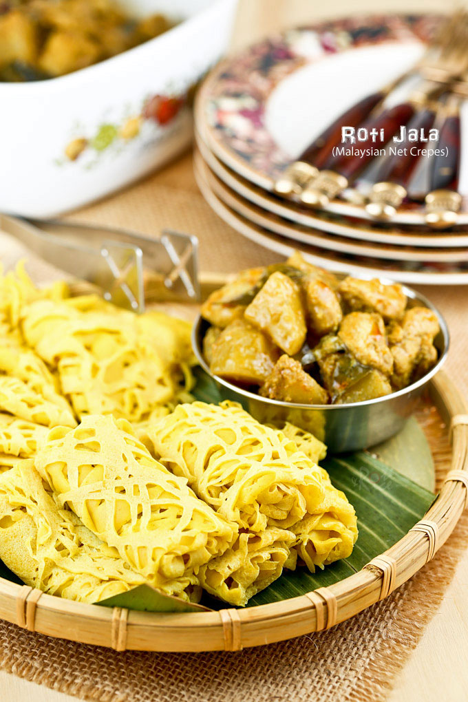 Tender and delicate Roti Jala served with Chicken Curry.