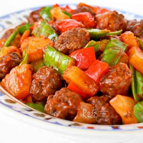 Treat your family to these tender and delicious Sweet and Sour Meatballs combined with bell peppers, snow peas, and pineapples. Homemade is the best! | RotiNRice.com