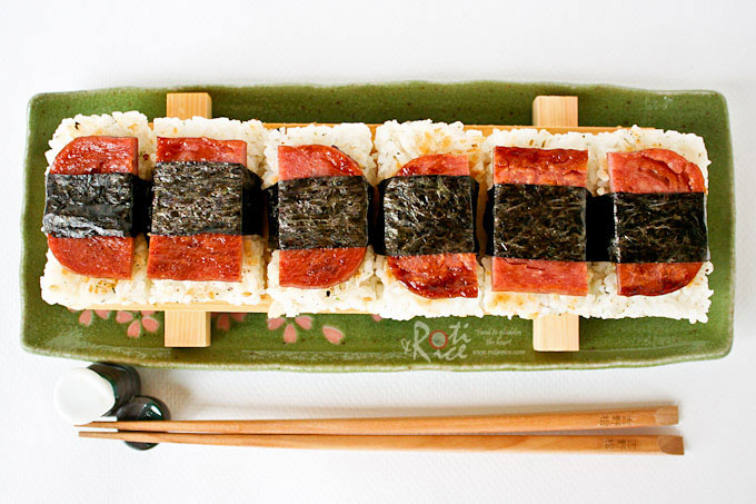 Spam Musubi is a ubiquitous snack and lunch food in Hawaii comprising of a slice of Spam and a slab of rice wrapped together with nori or dried seaweed. | RotiNrice.com #spammusubi #spamsnack #luncheonmeat