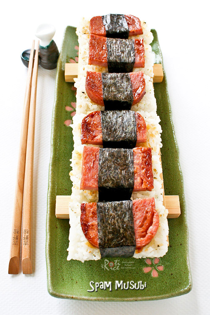 Delicious Spam Musubi lined up on a long plate.