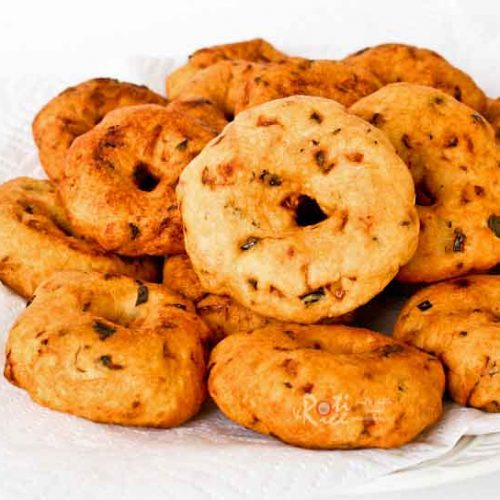 Ulundhu vadai is a popular South Indian snack. It is made of urad dhal combined with chilies and spices, eaten on its own or with coconut chutney. | RotiNRice.com