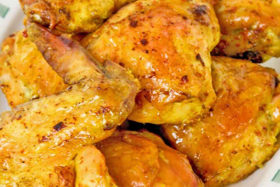 Ayam Panggang Kunyit made with fresh turmeric.