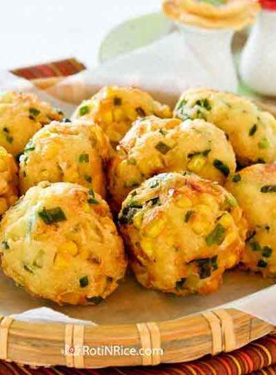 These tasty Tofu, Corn, and Chive Fritters make delicious snacks and appetizers. They are crunchy on the outside and soft on the inside.   RotiNRice.com #tofurecipes #cornrecipes #chives #fritters