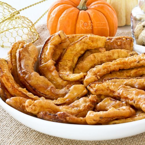 Golden Pumpkin Pakoras coated with chickpea flour, garam masala, chili powder, ground turmeric, and cumin seeds. They are crispy crunchy and gluten free. | RotiNRice.com