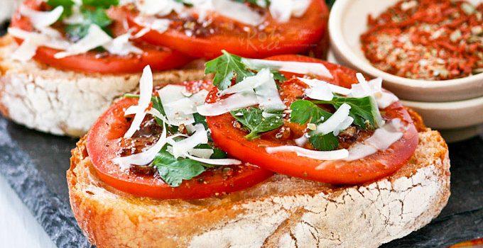 Bruschetta al Pomodoro (Bruschetta with Tomatoes) - juicy vine ripened tomatoes, Italian parsley, and freshly shaved parmesan reggiano on ciabatta. | RotiNRice.com