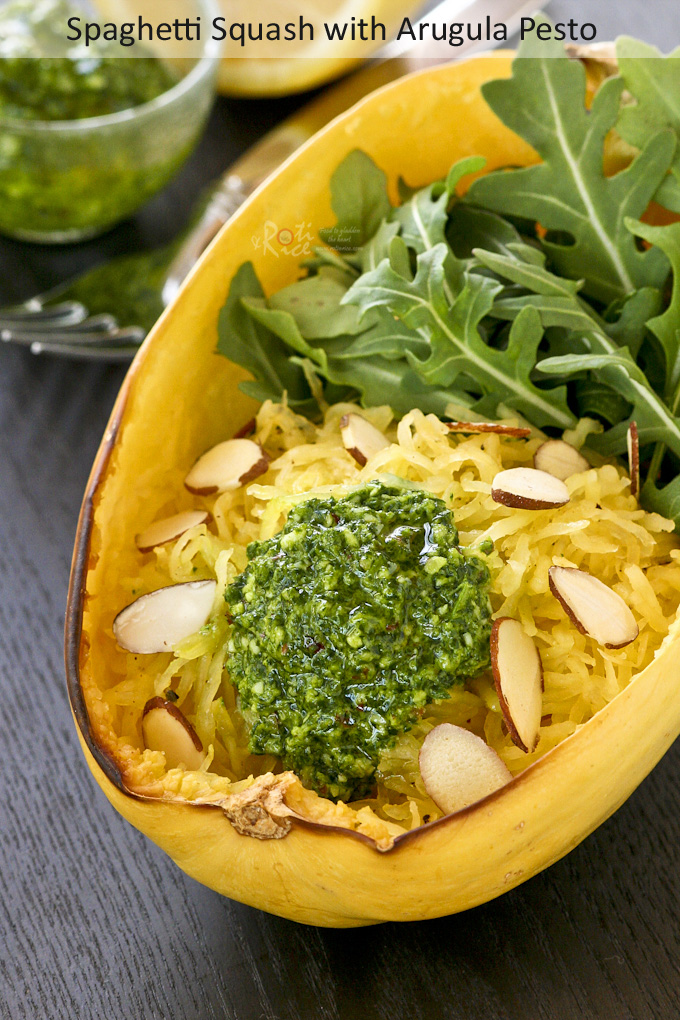 Spaghetti Squash with Arugula Pesto served in a spaghetti squash bowl.