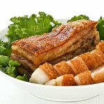 Crispy, crunchy, crackly Roast Pork Belly is a favorite of many. It can be made at home with just 4 ingredients and a little bit of patience. | RotiNRice.com #siewyoke #siuyuk #crispyporkbelly