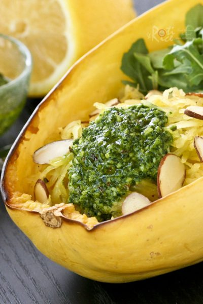 Make a light and incredibly tasty salad or meal with this Spaghetti Squash with Arugula Pesto. It is perfect for those on a gluten free diet. | RotiNRice.com #spaghettisquash #pesto #arugula #glutenfree