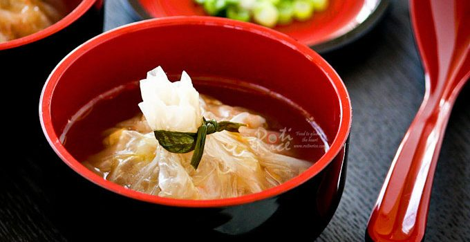 These Money Bag Dumplings are a feast for the eyes and palate. They are made gluten free using translucent rice wrappers and napa cabbage.   RotiNRice.com
