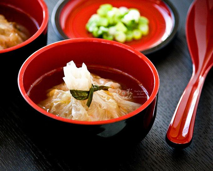Money Bag Dumplings served in a bowl of chicken broth.