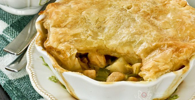 Easy to prepare Potato, Leek, and Chicken Pot Pie topped with crispy puff pastry. It is warm, comforting, and delicious. | RotiNRice.com