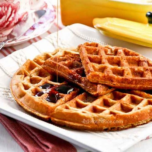 Light and fluffy Banana Buttermilk Waffles with a moist interior and a crispy exterior. Whole oat flour makes these waffles gluten free. | RotiNRice.com