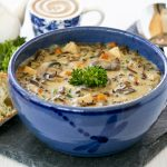 This Chicken Wild Rice Soup is a hearty creamy soup made with cooked chicken, nutty wild rice, and mushrooms. It is a bowl of comfort any time of the year. | RotiNRice.com #chickensoup #wildrice #souprecipes #wildricerecipes