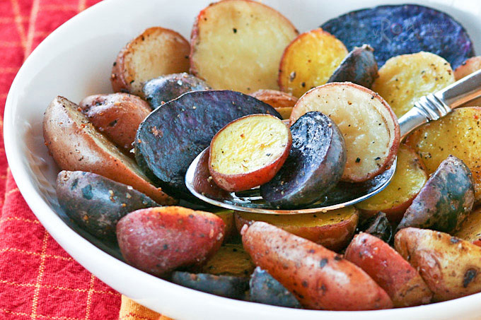 These Roasted Fingerling Potatoes are creamy and buttery on the inside with a crisp and salty exterior. Delicious with grilled meats, poultry, or fish. | RotiNRice.com