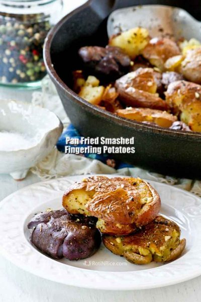 These Pan Fried Smashed Fingerling Potatoes are so tender and buttery on the inside with a very tasty and slightly salty crust. They are just the perfect side dish! | RotiNRice.com