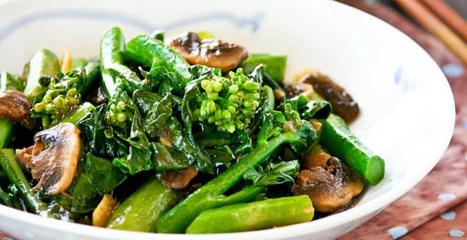 Learn the technique to cook your own tender crisp Stir Fry Gai Lan (Chinese Broccoli) with mushrooms at home. Takes only a few minutes to prepare. | RotiNRice.com