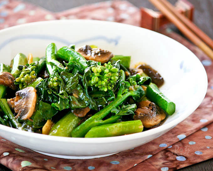 Delicious Stir Fry Gai Lan (Chinese Broccoli) with mushrooms.