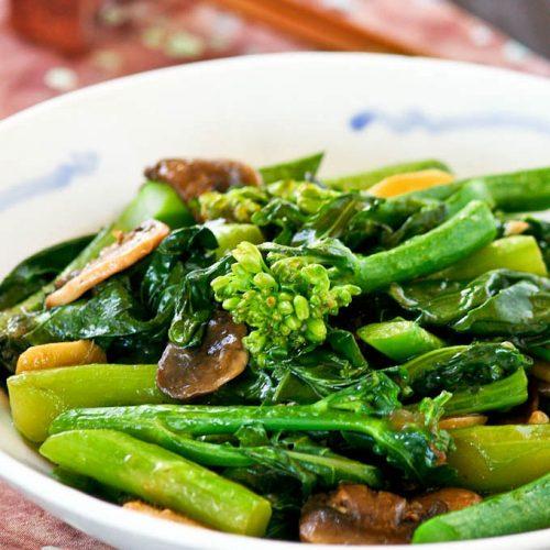 Tender crisp Stir Fry Gai Lan (Chinese Broccoli) with mushrooms.