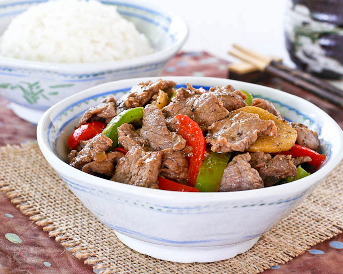 This robust and flavorful Black Pepper Beef Stir Fry combines thin slices of beef with freshly ground black pepper, ginger, and sweet bell peppers. | RotiNRice.com