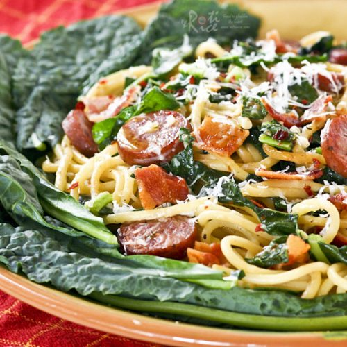 Kale Sausage Spaghetti - a pasta with bold flavors combining Polish sausage, earthy kale, spicy red pepper flakes, garlic, and bacon.   RotiNRice.com