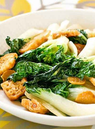 Delicious tender crisp Stir Fry Bok Choy with ginger, garlic, and slices of deep fried tofu to provide a contrast of textures and flavors. | RotiNRice.com