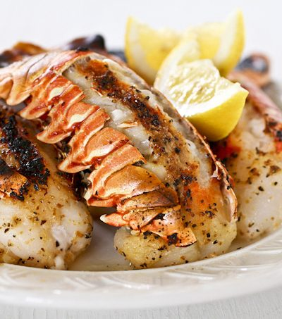 Get fancy with these succulent Broiled Lobster Tails flavored with lemon pepper butter for that special occasion. It is totally worth it! | RotiNRice.com #lobstertails #lobsters #broiledlobstertails