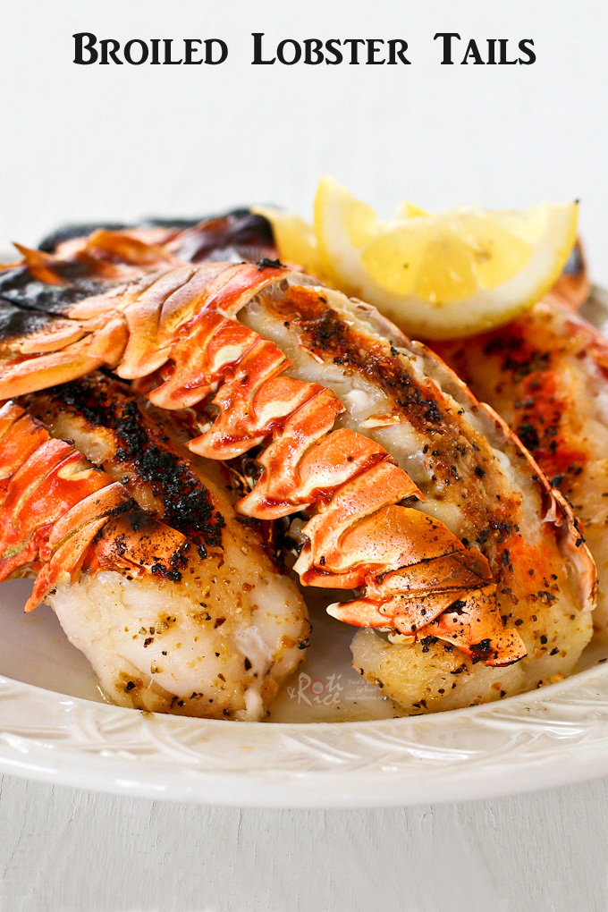 Broiled Lobster Tails served with lemon wedges.