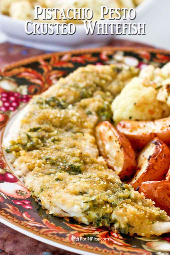 Pistachio Pesto Crusted Whitefish served with roasted cauliflower and baked spicy garlic potato wedges