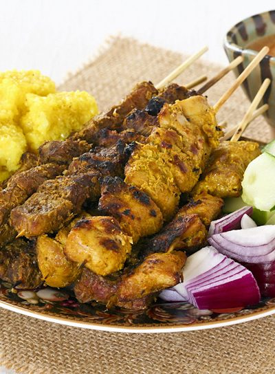These aromatic and tender Beef and Chicken Satay are a must try. Delicious served with Satay Peanut Sauce and chunks of onions and cucumber. | Food to gladden the heart at RotiNRice.com