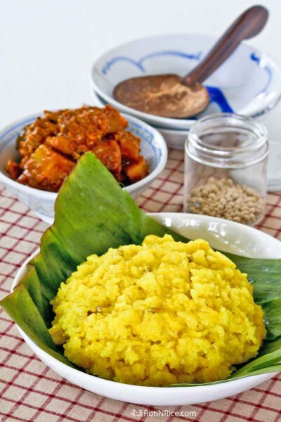 Nasi Kunyit (Turmeric Glutinous Rice) served with Chicken Curry