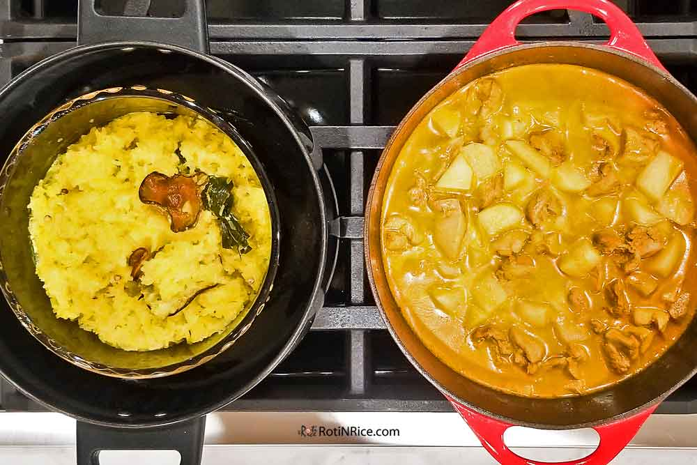 Freshly steamed Nasi Kunyit (Turmeric Glutinous Rice) with Chicken Curry on the stove.