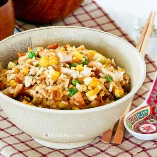 Chicken and Corn Fried Rice - a quick, simple, and tasty fried rice made with left-over grilled chicken and fresh seasonal corn.   RotiNRice.com