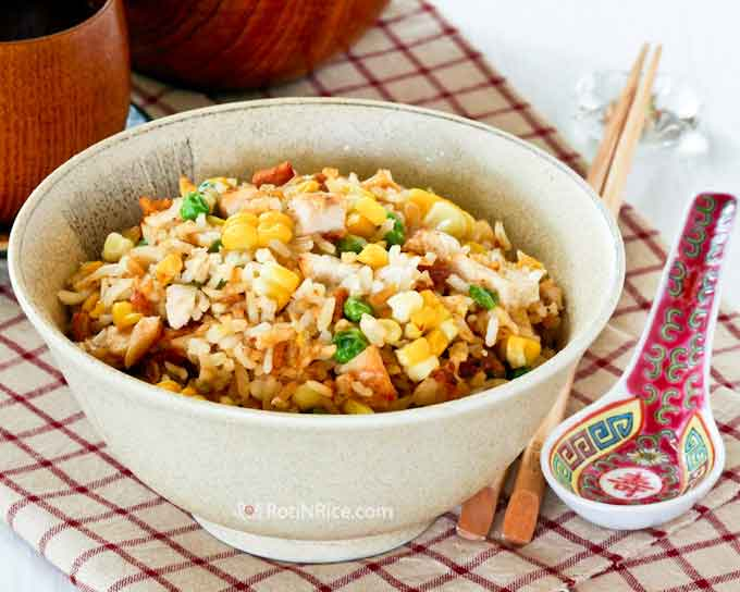 Chicken and Corn Fried Rice - a quick, simple, and tasty fried rice made with left-over grilled chicken and fresh seasonal corn. | RotiNRice.com