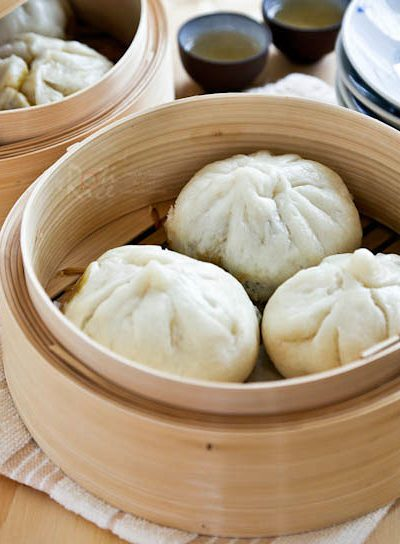 Make your own soft, white, and fine textured steamed Char Siew Bao filled with sweet barbecued pork filling. With step-by-step instructions. | RotiNRice.com