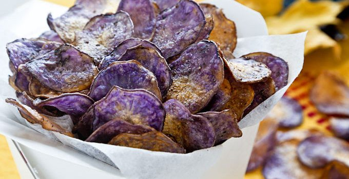 Homemade Baked Potato Chips flavored with salt, pepper, and thyme. Conventional potatoes may be used but Purple Majesty potatoes make these chips stunning!   RotiNRice.com