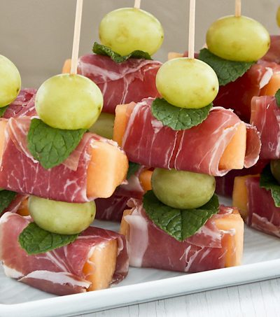 Prosciutto Wrapped Melon - an easy no-cook sweet salty appetizer perfect for the holidays. Use decorative food picks to make a fun and lovely presentation.   Food to gladden the heart at RotiNRice.com