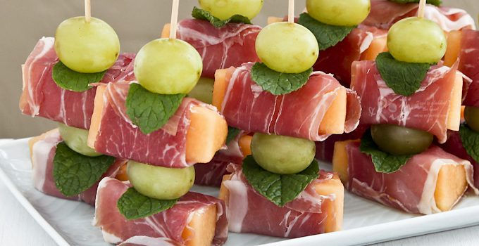 Prosciutto Wrapped Melon - an easy no-cook sweet salty appetizer perfect for the holidays. Use decorative food picks to make a fun and lovely presentation. | Food to gladden the heart at RotiNRice.com