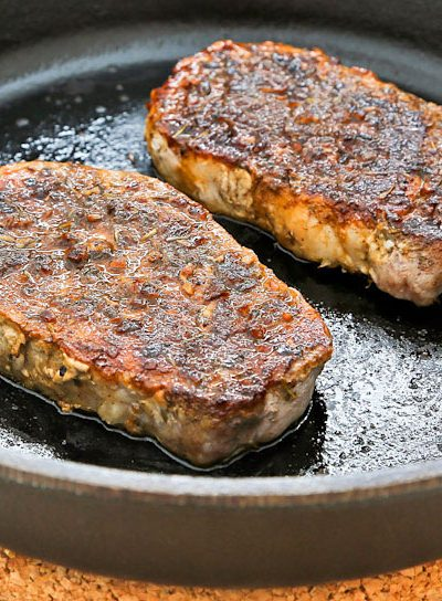 These tender and juicy Pan Roasted Pork Loin Chops are perfect for weeknight meals. Flavor them with your favorite dry rub. Only minutes to prepare.   RotiNRice.com #porkloinchops #porkchops #weeknightmeals