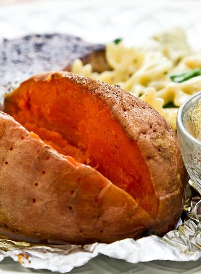 Whole Baked Sweet Potatoes make a great side dish. They are delicious served as is or with a little butter and a sprinkling of cinnamon sugar.   RotiNRice.com