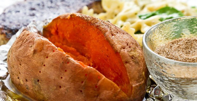 Whole Baked Sweet Potatoes make a great side dish. They are delicious served as is or with a little butter and a sprinkling of cinnamon sugar. | RotiNRice.com