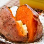 Whole Baked Sweet Potatoes served with butter.